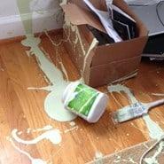 Paint spilled across a floor.