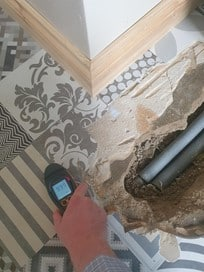 Property Claims Loss Assessor carries out checks to a water damaged house.