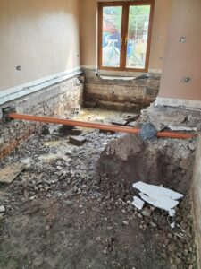 A house undergoes repairs following an oil leak.