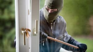 A man breaking the lock of a door to a house. Do you need to make a theft or burglary claim?